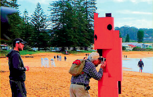 A photographer fi nds an unexpected use for the Floating Illusion sculpture on Avoca Beach Photo: Allan Lambel