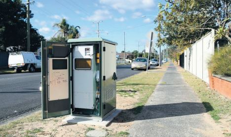 NBN Fibre to the Node cabinet on a roadside verge.