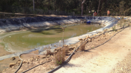 A Gosford Council photograph from 2012 of a leachate pond at the landfi ll shows pipes and sprinklers indicative of poor water resource management