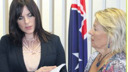 Member for Robertson, Ms Lucy Wicks receiving a copy of the petition from Ms Lindy Hewitt