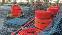 Coiled hoses inside the landfi ll site near the alleged discharge point