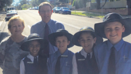 Scot MacDonald with St Patrick's Primary School Principal Cheryl Walsh and students