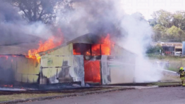 Fire crews battle the blaze at the Pavilion which covered the area around the Gosford Showground in thick smoke