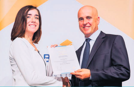 St Peter's school student Kimberely Weeks receiving her certifi cate of excellence from Minister Piccoli
