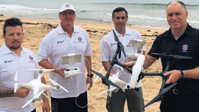 Drone instructors holding and operating equipment