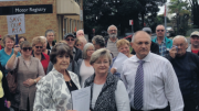 Ms Kathy Smith (front left) campaigning to keep the Woy Woy Motor Registry open in 2015