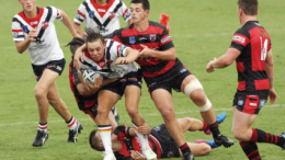 Under 18s fullback Blake Taaffe struggles to break free against Norths