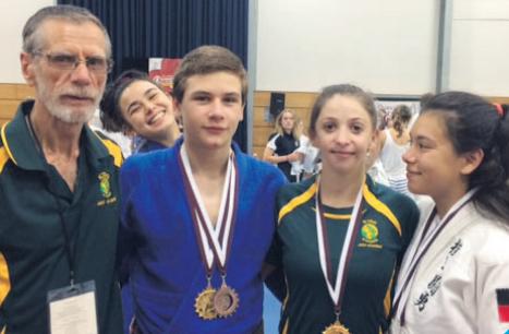 From left: Pete Acciari with Daniel Villani, Caroline Hain and Angelina Yokoyama