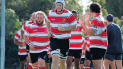 Woy Woy's 1st Grade Captain, Kane Burns, leading the team out in the Round 2 Match against Warnervale