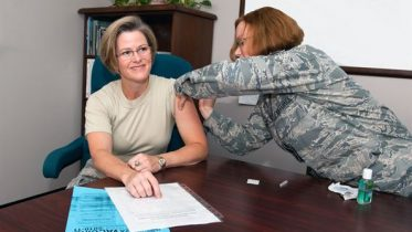 A regular flu shot being administered