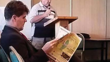 Former Wyong Mayor Doug Eaton listens to a local resident submission about amalgamations.