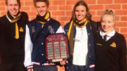 Gosford HS leaders Dylan James and Jacquie Belcher (centre) with Orange HS students and the Malynley Shield