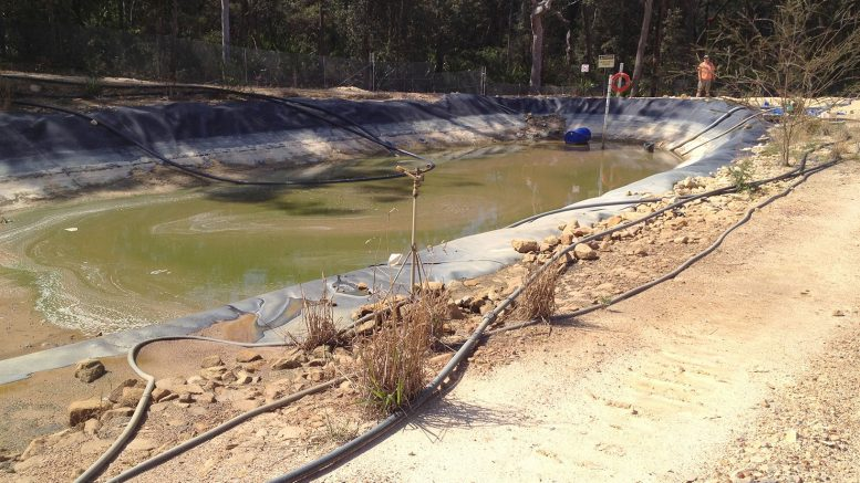 A Gosford Council photograph of a leachate pond at the landfill shows pipes and sprinklers indicative of poor leachate management. Archive image 2016