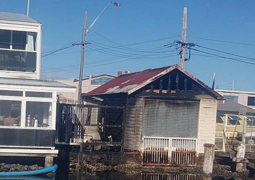 The fi re-damaged NSW Fisheries boatshed next to Fisherman's Wharf at Woy Woy Photos: Tim Conway