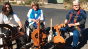 Ms Trudy Dekeijzer, Ms Donna Grech and Ms Denise James with their spinning wheels at Patonga's Bakehouse Art Gallery this July