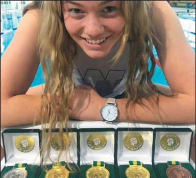 Umina athelete Kaylah Holmes with her 2017 Pool Rescue Championship medals