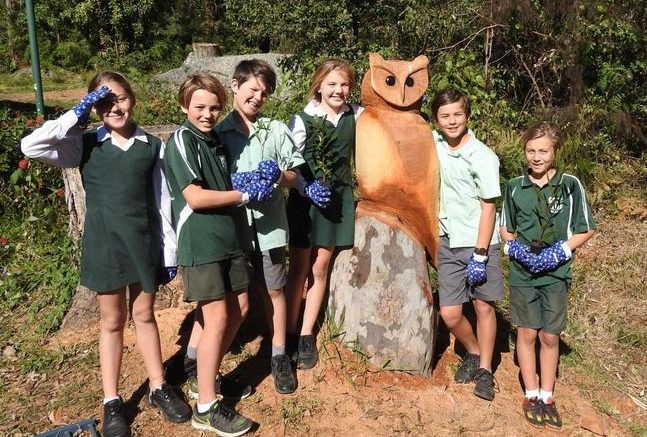 Students at Pretty Beach at a bush tree planting. Image: School Website