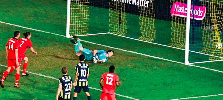 Ben Kennedy looks behind to see Adelaide's fi rst goal in his net Photo: Noel Plummer
