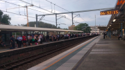 City bound commuters waiting at Gosford station.
