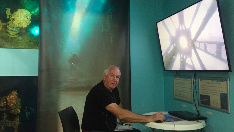 Marine Discovery Centre Manger John Asquith showing off the VR tour of the wreck of the HMAS Adelaide