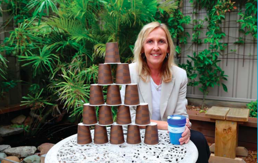 Mayor Jane Smith illustrating how many single use coffee cups she diverts from landfill through the working week
