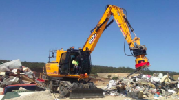 The materials handling excavator in action