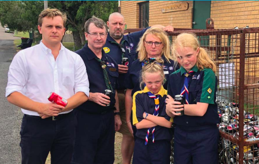 Mr Taylor Martin with 1st Scout Group Wyong scouts and leaders. Image supplied.