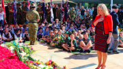 Ms Karen McNamara laying a wreath at Toukley RSL at a previous ANZAC Day service