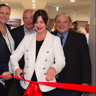 Member for Robertson Ms Lucy Wicks cuts the ribbon, while hospital chief Ms Kathy Beverley, Dr John Caska and Mr Geoff Sims look on