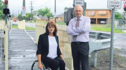 Member for Gosford Ms Liesl Tesch with Shadow Minister for the Central Coast Mr David Harris at the level crossing