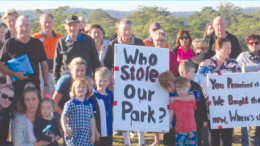 Gwandalan residents gathered at the site of their deleted playground to call for assistance from Central Coast Council
