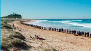 "A recent 'hands across the sand"" event at Newcastle's Nobby's Beach against the seismic testing"