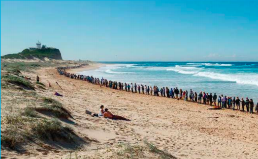 """A recent 'hands across the sand"""" event at Newcastle's Nobby's Beach against the seismic testing"""