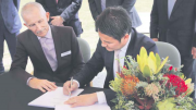 Rob Noble (former CEO, Central Coast Council) and Khoa Hoang (President, Amphibian Aircraft Group) signed the 40 year lease in 2016