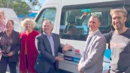 Member for Terrigal, Mr Adam Crouch (centre), with some of Coast Connect's first commuters and Mr Kevin Orr of Liftango (far right)