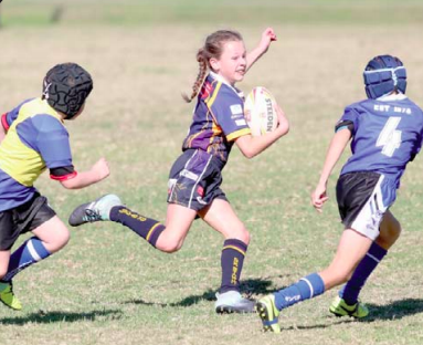Kellie Hodge goes for a scamper during the Gosford U10s loss to Budgewoi