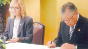 Mayor Smith and Mayor Tada re-sign the sister city agreement