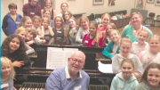 Chidrens' Chorus Leader, Mr Phillip Rewes with Conservatorium children