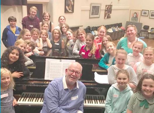 Chidrens' Chorus Leader, Mr Phillip Rewes with Conservatorium children