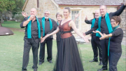 Ms Elke Hook (centre) with Mr Christopher Bowen, Ms Lilli Naulu, String Quartet and Chorale Members