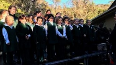 The Pretty Beach School Choir performed at the 5 Lands Walk 2018