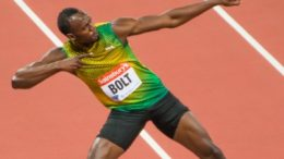 Usain Bolt giving his trademark salute. Image: Wikimeida