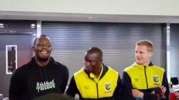 Usain Bolt with Mariner's defender Kalifa Cisse and attacker Matthew Simon