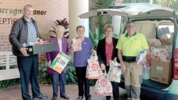 Tarragal Glen Village residents and staff loading their collected goods for donation