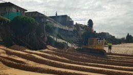 Central Coast Council burying the ACM on Wamberah Beach, June 22, 2017