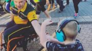 A student 'high-fives' an Invictus Games athlete.
