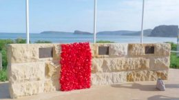 them unveil to poppy panels to embellish the Ocean Beach War Memorial