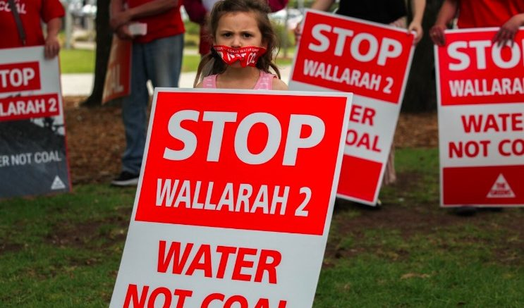 Scene from a recent protest against the Wallarah 2 proposal. Image: Alex Herget - parental permission granted for singular publiser use.