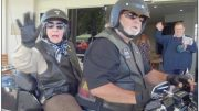 Ms Marion Anderson sits pillion with a member of the Ulysses Motorcycle Club