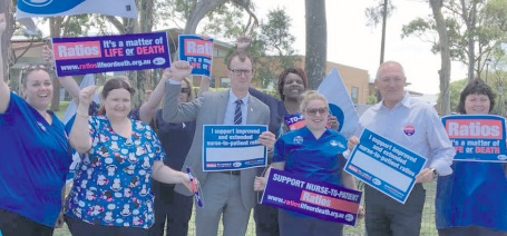 Wyong Hospital NSW Nurses and Midwives Association branch members, Geriatric Unit staff, and the Members for The Entrance and Wyong, David Mehan and David Harris, at the rally